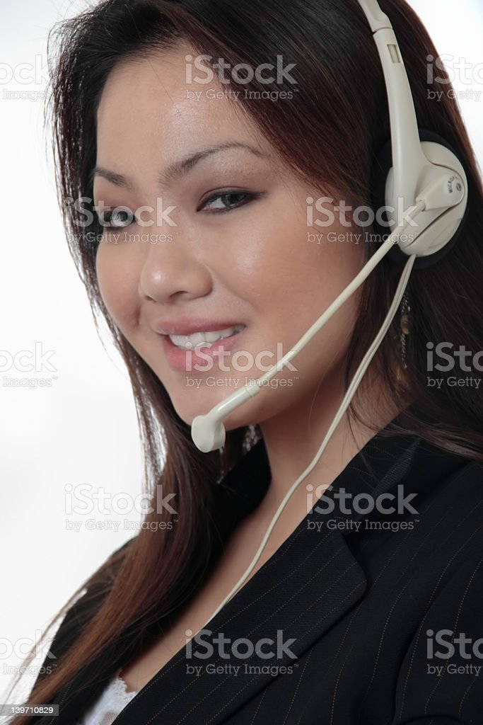 Attractive receptionist wearing headset royalty-free stock photo