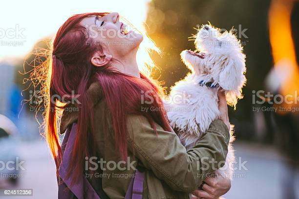 Attractive redheaded girl and white puppy smiling together picture id624512356?b=1&k=6&m=624512356&s=612x612&h=zfeiyhhfrs58rlrc frpwhyxeio4hfomla5qxwsim0g=