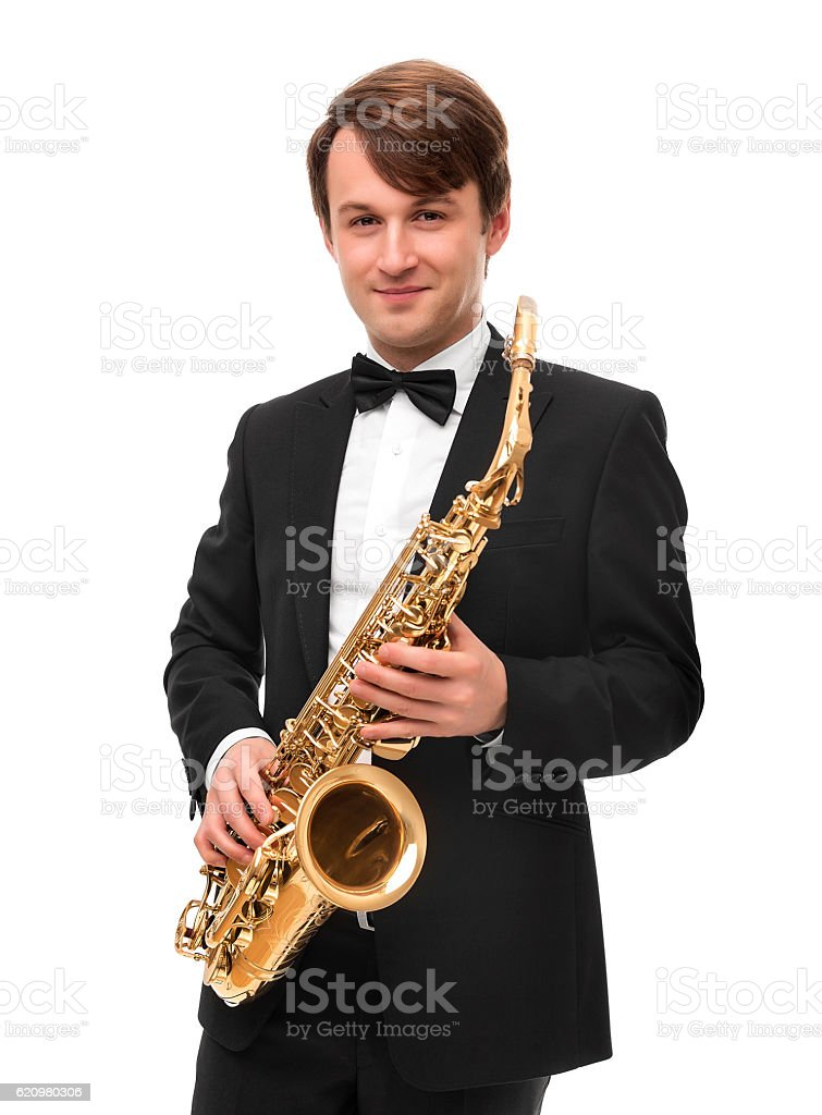 Attractive saxophonist with a saxophone in a suit. foto royalty-free