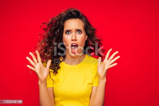 Attractive scared young woman