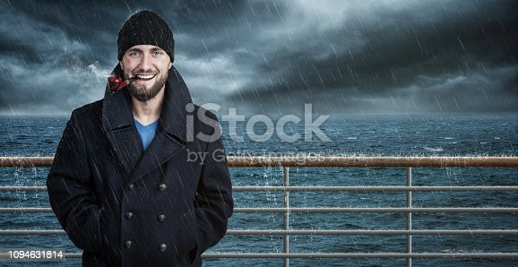 istock Attractive seafarer on his ship in bad weather 1094631814