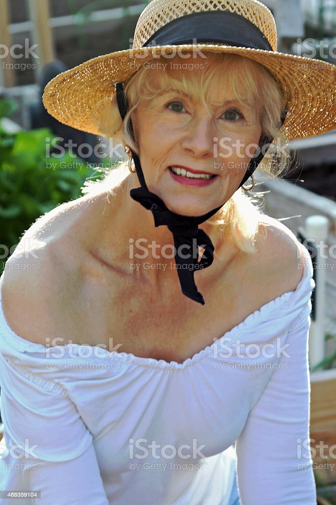 Attractive Senior Adult Female Looking At The Camera royalty-free stock photo