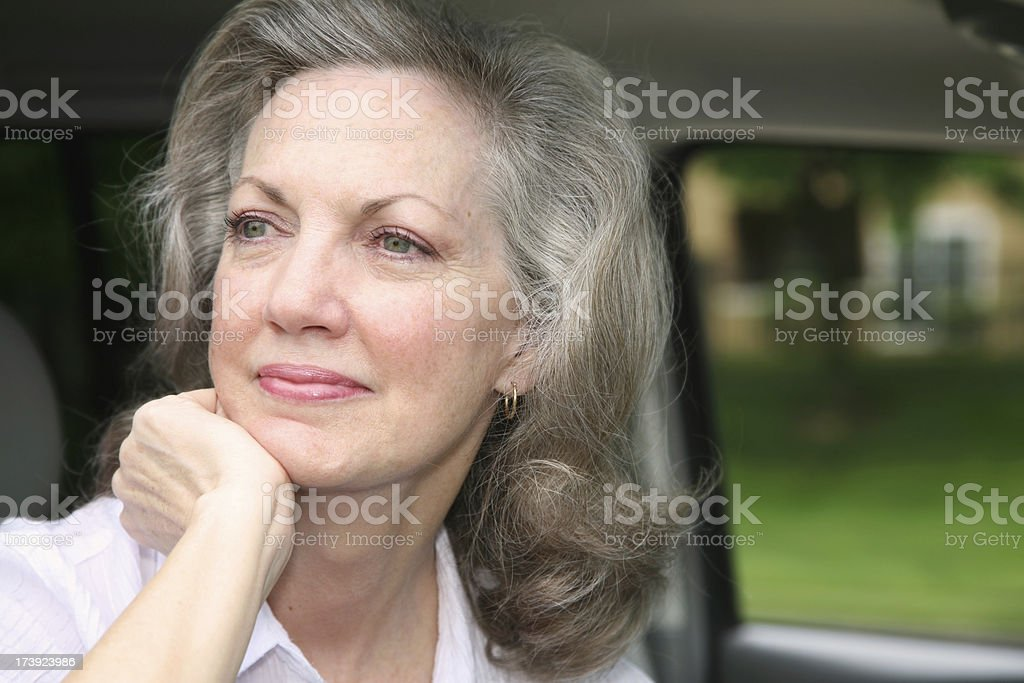 Attractive Senior Adult Woman Pondering Life in Her Car royalty-free stock photo