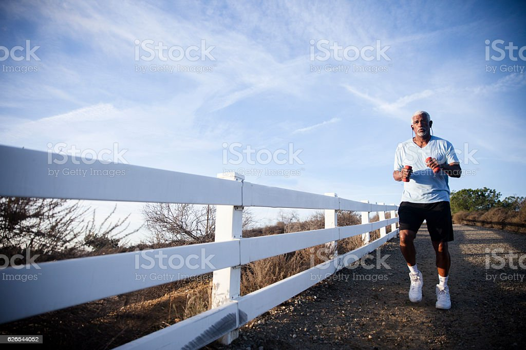 Attractive Senior Man Jogging stock photo