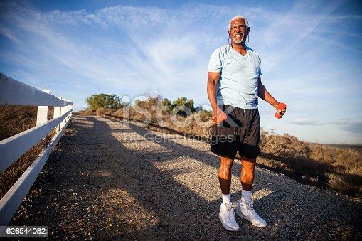 istock Attractive Senior Man Jogging 626544082