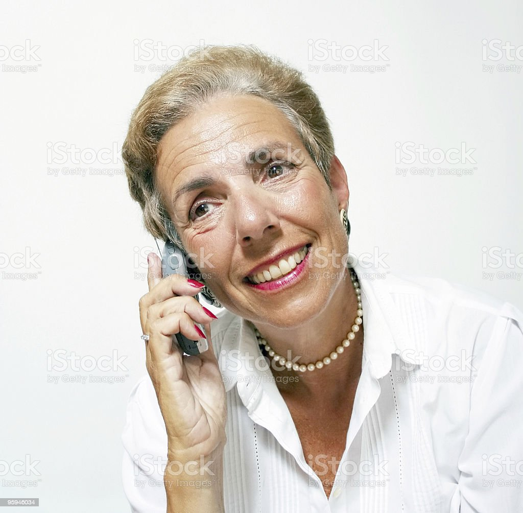 Attractive Senior Smiling and Talking on the phone royalty-free stock photo