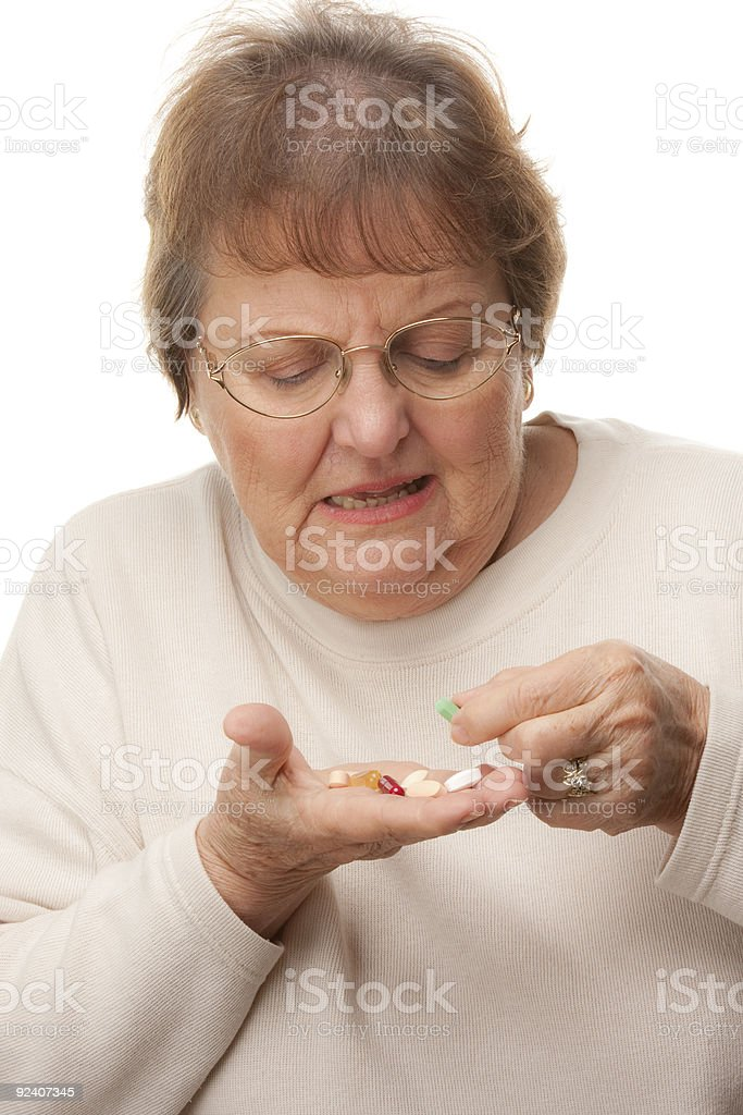 Attractive Senior Woman and Pills royalty-free stock photo