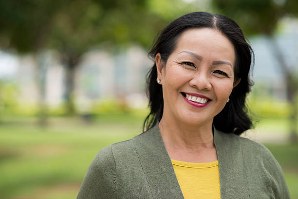 attractive senior woman - east asian ethnicity stock photos and pictures