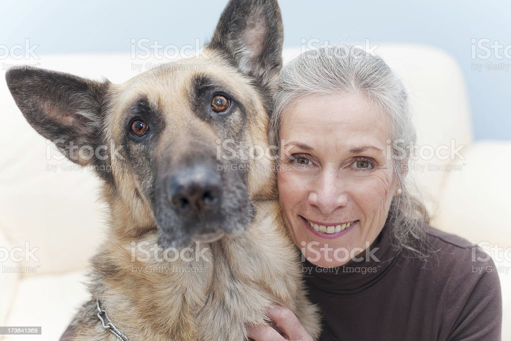 Attractive Senoir Woman with her pup royalty-free stock photo