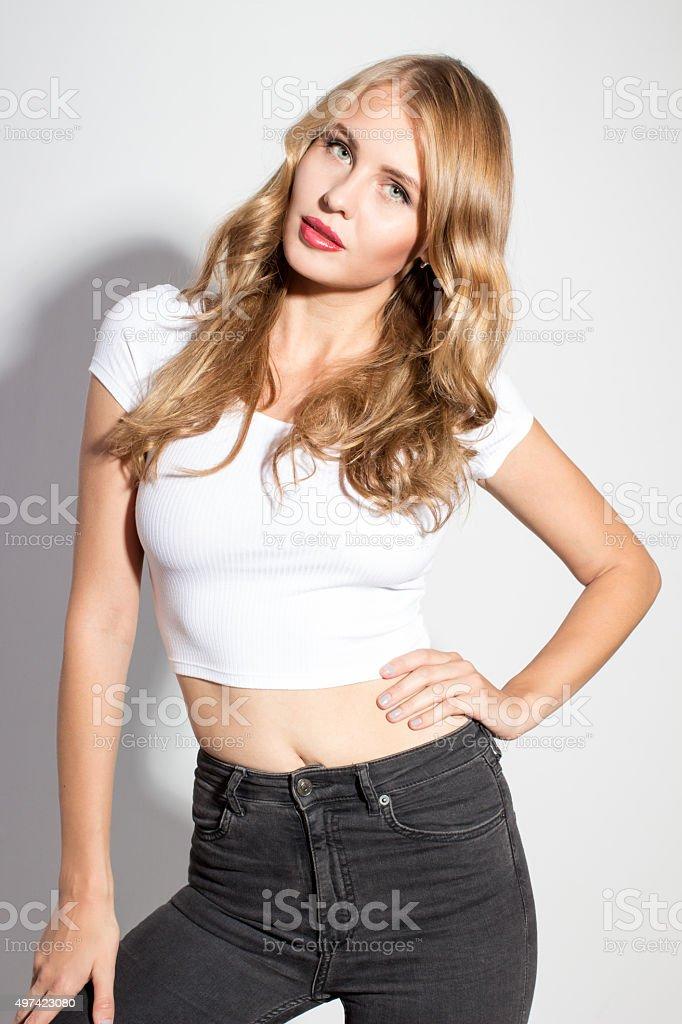 attractive sexy female fashion model posing in studio stock photo
