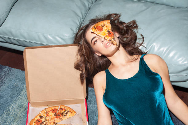 attractive sexy female model with pizza - bizarre stock pictures, royalty-free photos & images