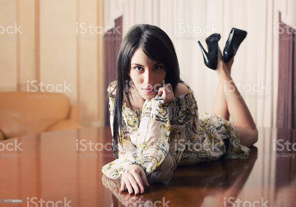 Attractive sexy girl lying on table royalty-free stock photo