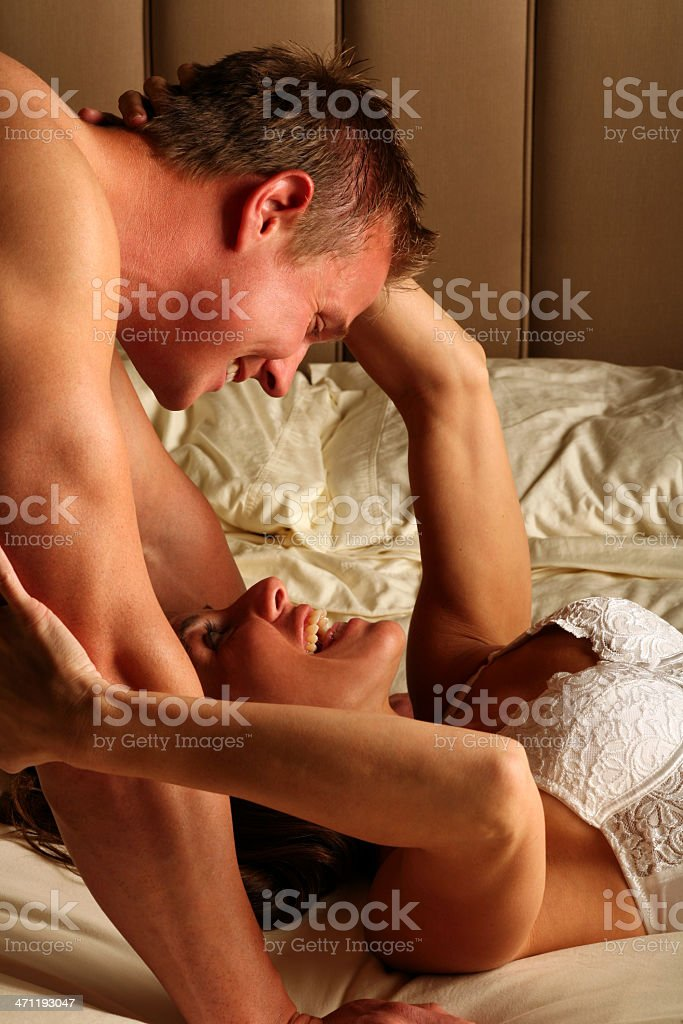 Attractive Sexy Loving Couple Embracing and Flirting in Bed royalty-free stock photo