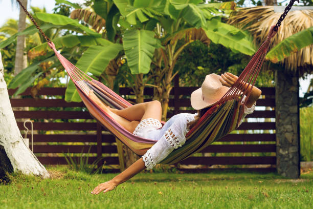 Attractive sexy woman relaxing in hammock. stock photo