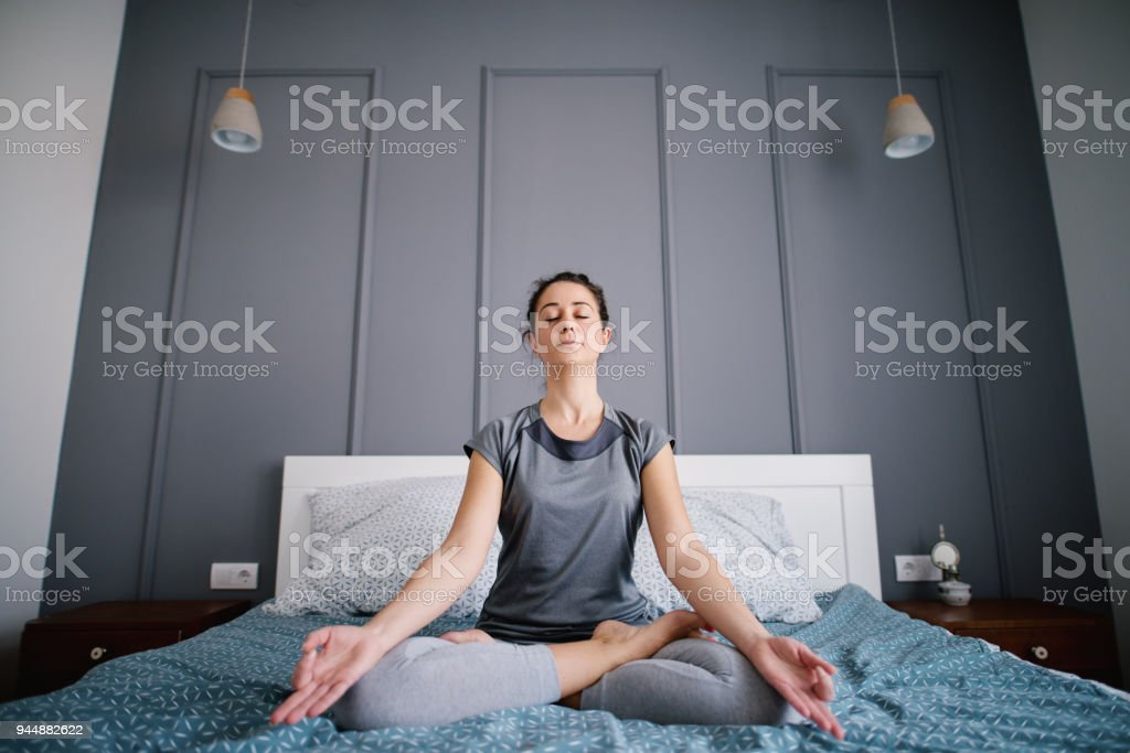 Attractive Shape Sporty Middle Aged Woman Doing Seated Yoga Poses On