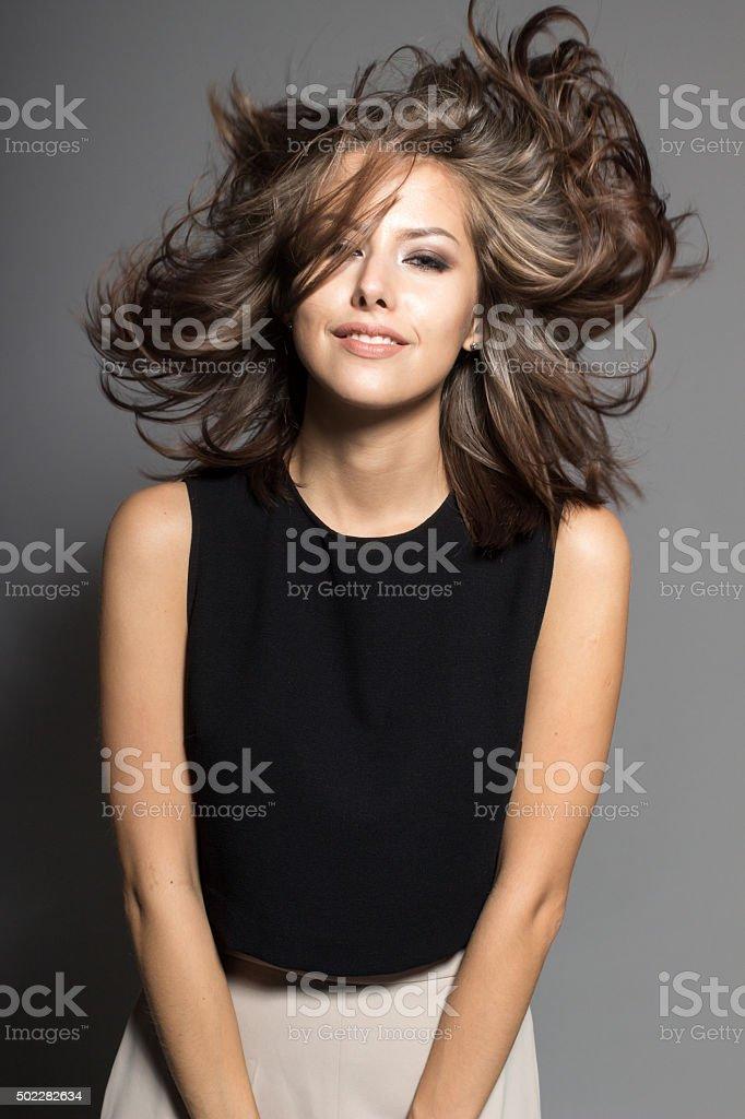 attractive shy sexy model posing in studio wearing black shirt stock photo