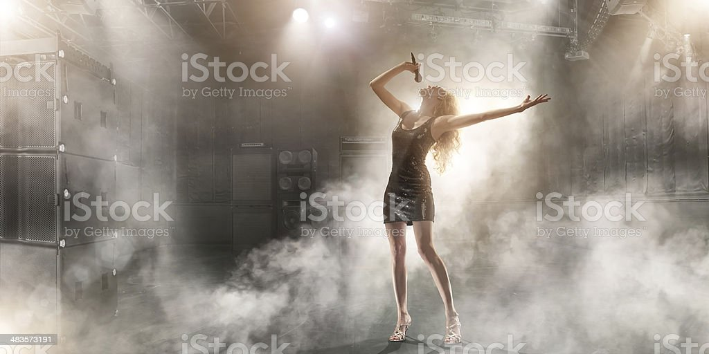 Attractive Singer Performing on Stage stock photo