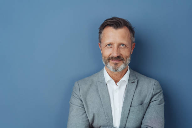 Attractive smiling bearded middle-aged man stock photo