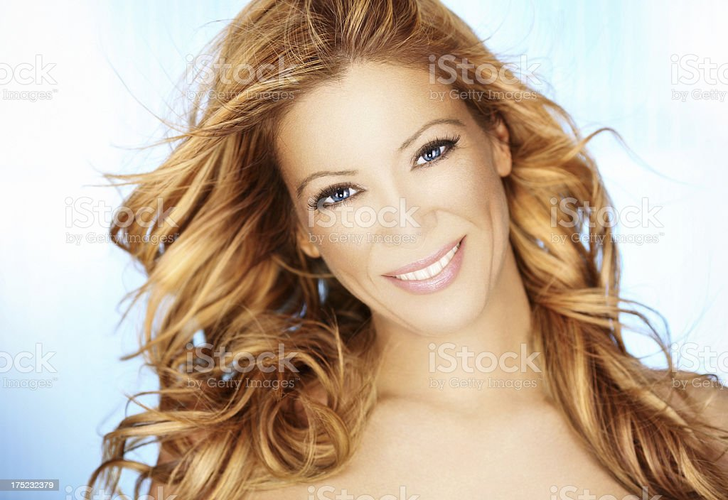 Attractive smiling blond with curly hair, closeup royalty-free stock photo