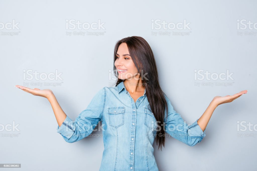Attractive smiling brunette woman showing balance with hands stock photo