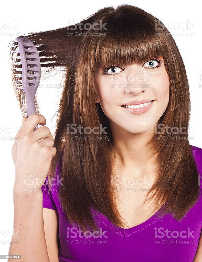 Attractive smiling woman brushing her hear royalty-free stock photo