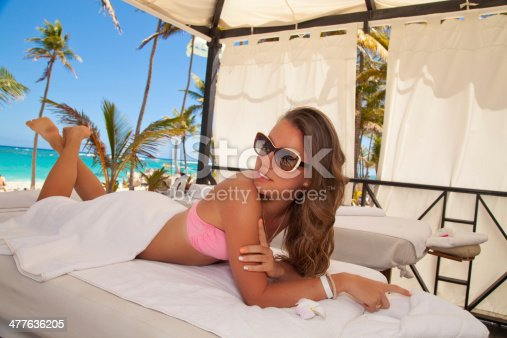 istock attractive smiling woman portrait on the beach in spa 477636205