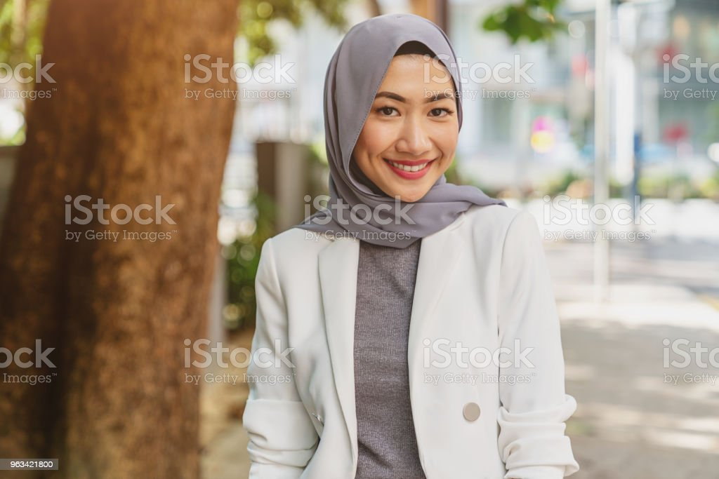 Attractive smiling young malaysian woman in kuala lumpur stock photo