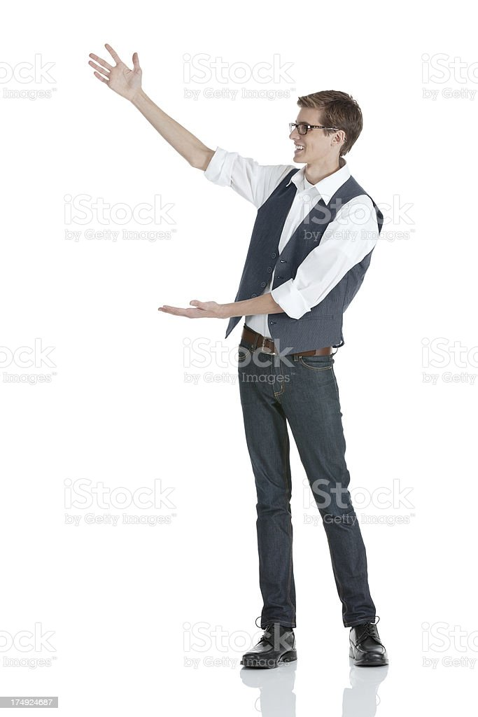 Attractive smiling young man gesturing royalty-free stock photo