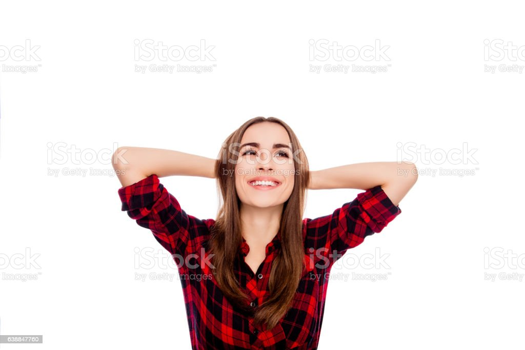 Attractive smiling young woman  lifted her hands up stock photo