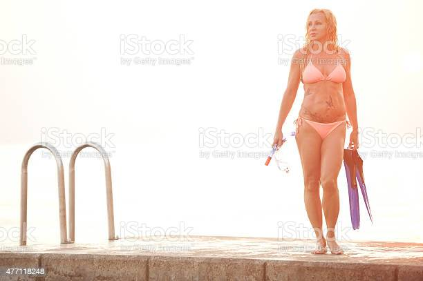 Attractive Snorkel Woman After Diving On A Pier Stock Photo - Download Image Now