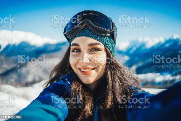 Attractive snowboard girl smiling and making selfie on mountain picture id1128933194?b=1&k=6&m=1128933194&s=612x612&h=kp1xwrd2p4gkav3o09nkq4kpmfbxlr1371jymibphyy=