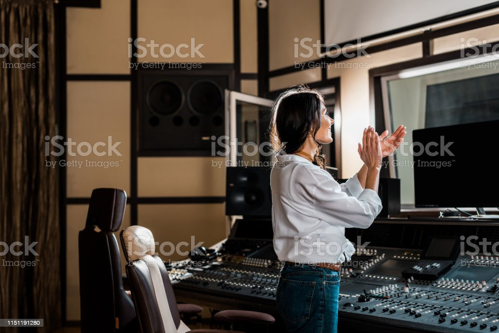 Attractive Sound Producer Applauding In Recording Studio