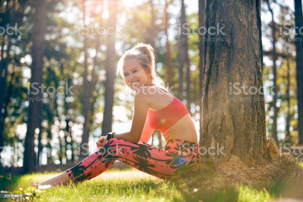 Attractive sportive woman taking a break after workout session. stock photo