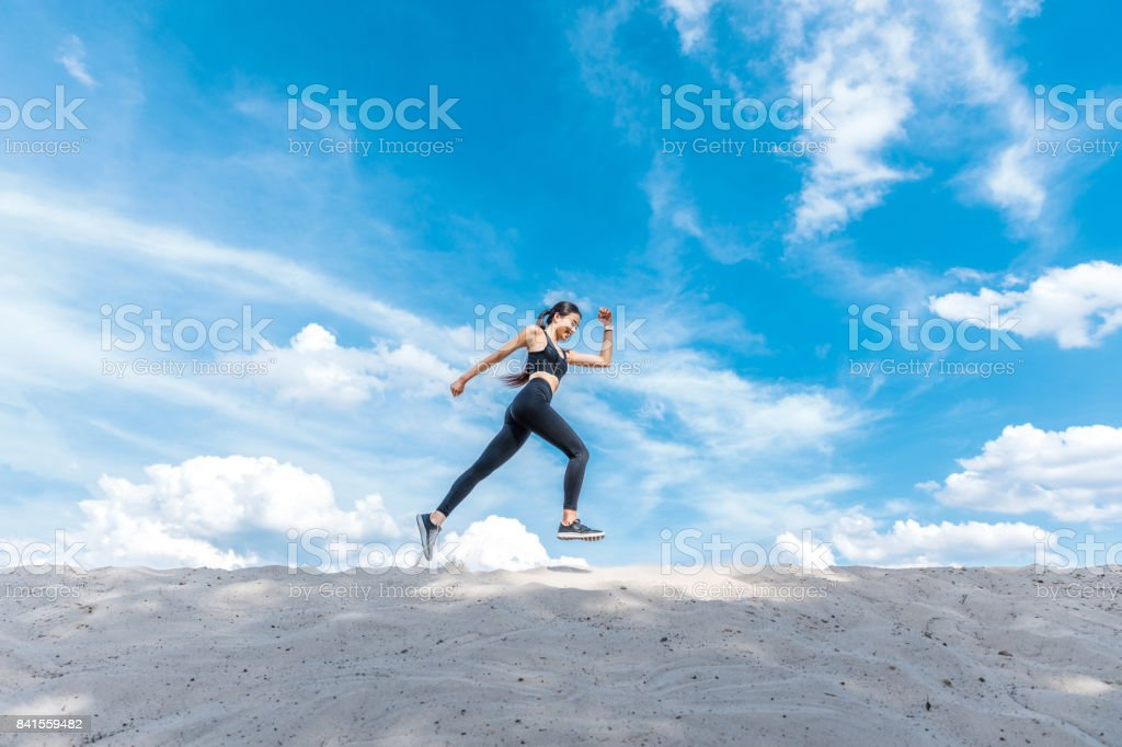 attractive sportswoman running stock photo