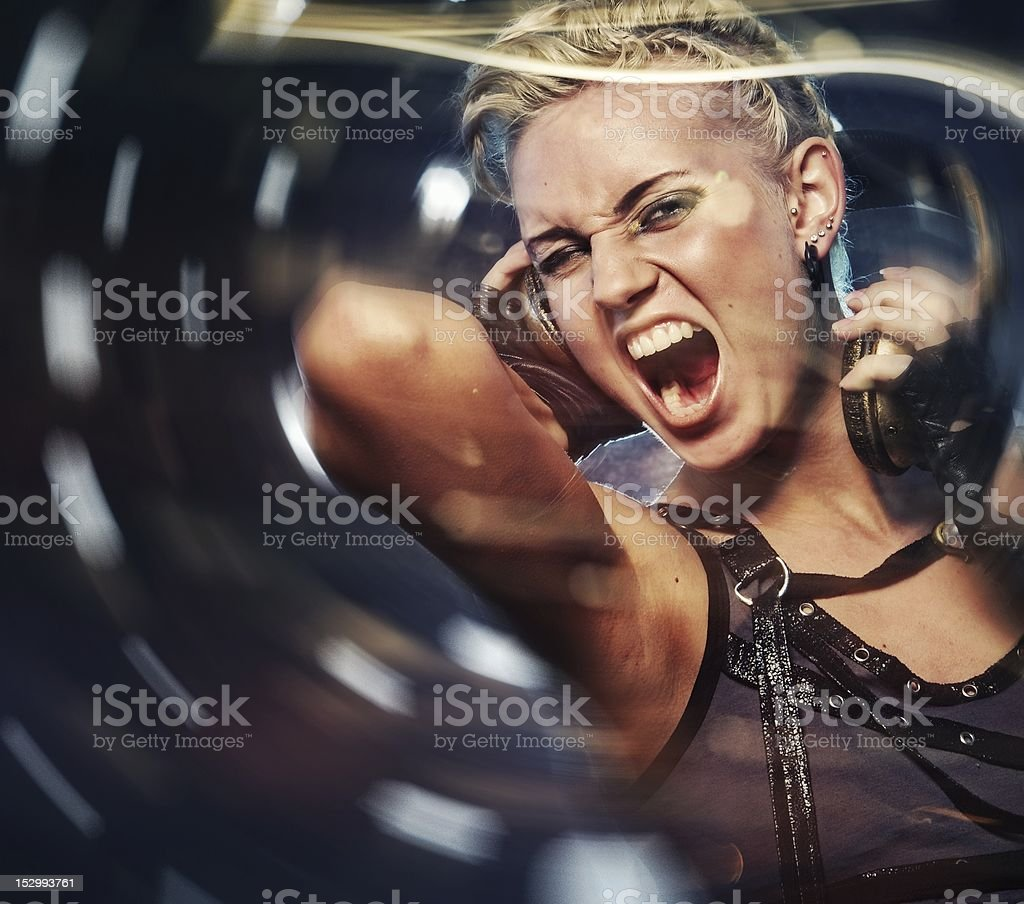 Attractive steam punk girl with headphones stock photo