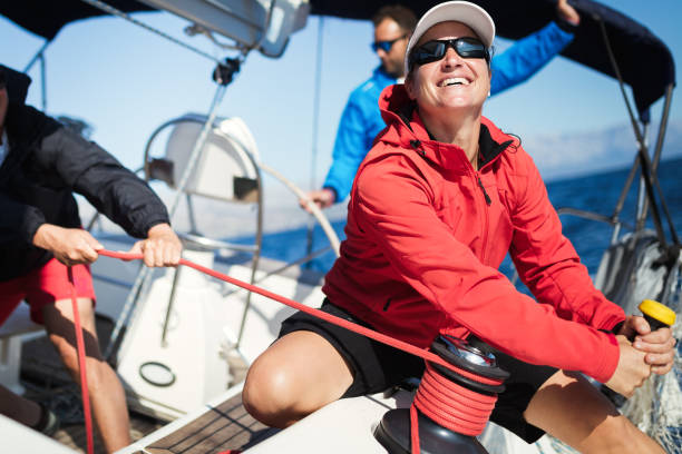 attractive strong woman sailing with her boat - sail stock pictures, royalty-free photos & images
