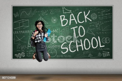istock Attractive student jumps in classroom 507124339