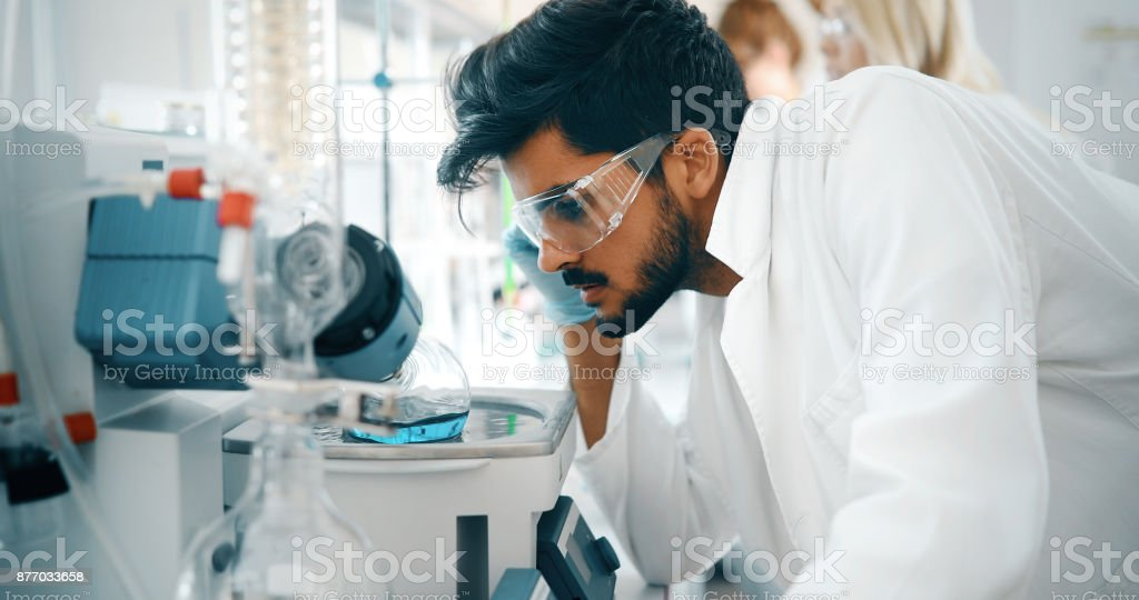 Attractive student of chemistry working in lab stock photo