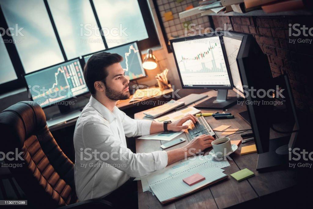 Attractive success young manager work in office. Indoor, studio shot....