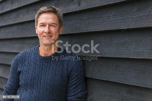 istock Attractive, successful and happy smiling middle aged man male outside wearing a blue sweater 851628528