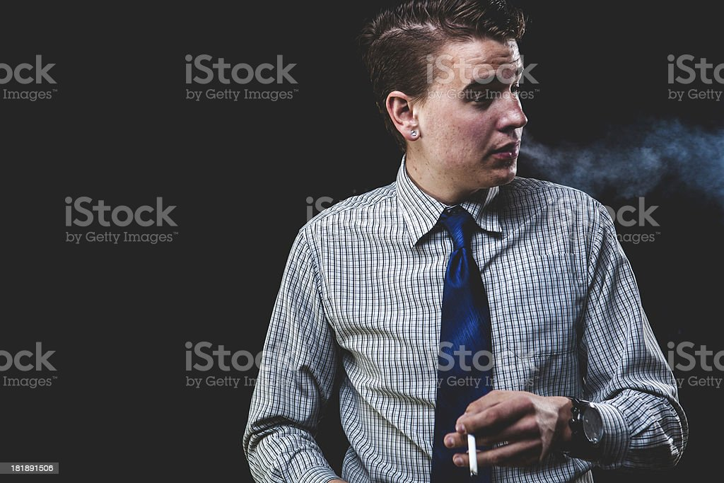 Attractive Successful Young Man Smoking Cigarette royalty-free stock photo