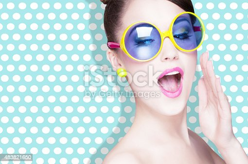 istock Attractive surprised young woman wearing sunglasses 483821650