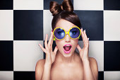 istock Attractive surprised young woman wearing sunglasses 505600759