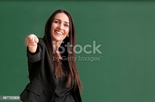 istock attractive teacher with long hair pointing at students 467702606