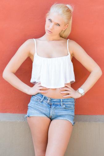 Happy Blonde Posing Against White Background Stock Photo