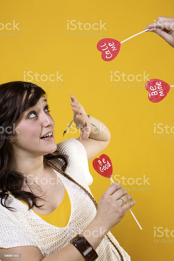 attractive Valentine heart lollipop girls royalty-free stock photo