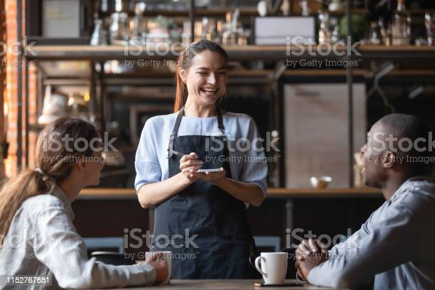 Attractive waitress laughing at african american man joke serving picture id1152767881?b=1&k=6&m=1152767881&s=612x612&h=7bd2kl03qvftw7pyyn iogb1qwkxivbz5fol gfcbjk=