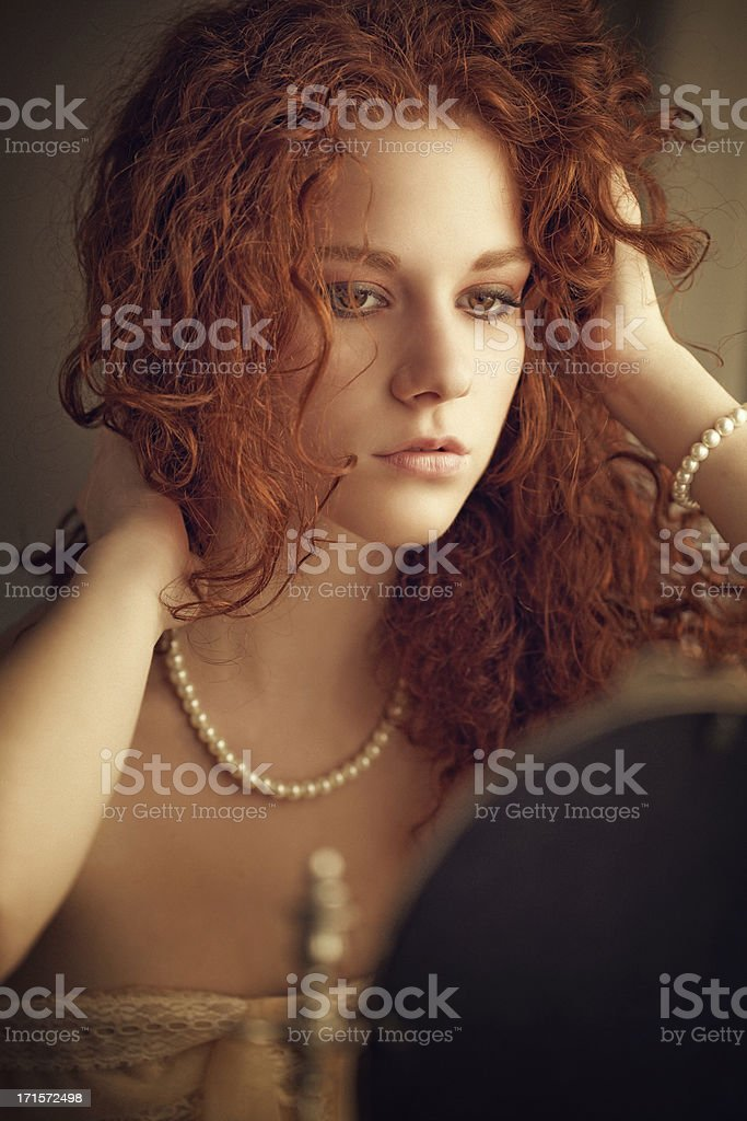 attractive woman adjusting her hair royalty-free stock photo
