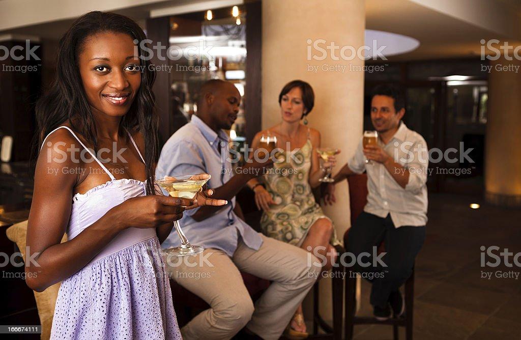 Attractive woman at a Bar stock photo