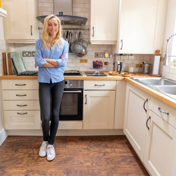 Attractive woman at home in the kitchen stock photo